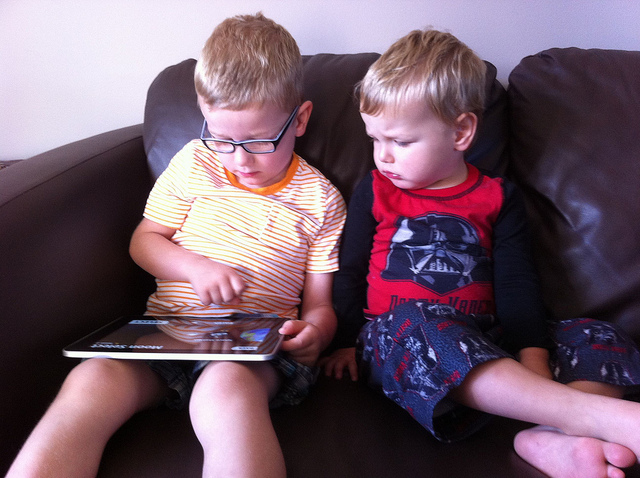Kids playing with Ipad
